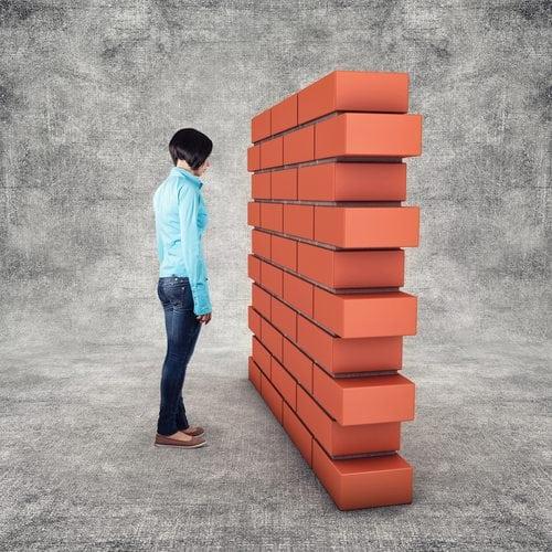 man with brick wall
